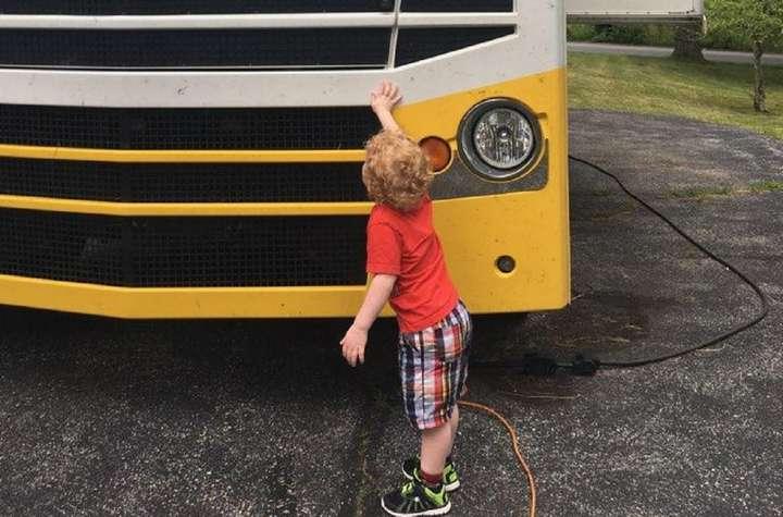 boy touching a bus